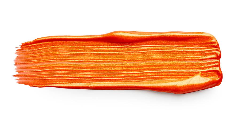 Orange paint stroke isolated on white background